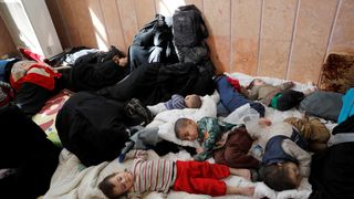Civilians who escaped from the Islamic State militants rest at a mosque in Raqqa