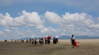Rohingya refugees walk to a Border Guard Bangladesh (BGB) post after crossing the Bangladesh-Myanmar border by boat