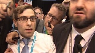 Simon Brodkin is led out of the conference hall in Manchester after handing a P45 form to the Prime Minister