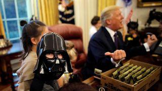 A boy dressed as Darth Vader meets President Trump