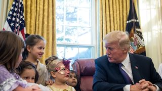 President Donald Trump meets children of journalists and White House staffers in the Oval Office