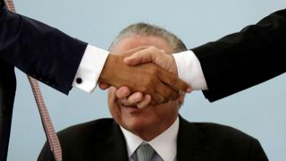 Brazil's President Michel Temer smiles during a ceremony in commemoration of the National Day of Micro and Small Enterprises at the Planalto Palace in Brazil