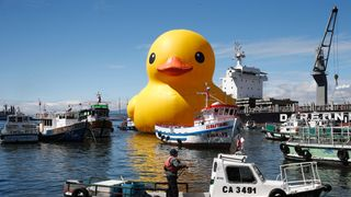 An installation of an inflatable Rubber Duck made by Dutch artist,  Florentijn Hofman, floats in Valparaiso port, Chile