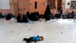 Civilians who escaped at Raqqa's frontline rest at a mosque in Raqqa, Syria
