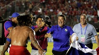 Panama's coach Dario Gomez celebrates with Roman Torres after Panama qualifies to the world cup for the first time in Panama City