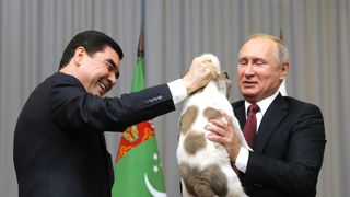 Turkmenistan's President Gurbanguly Berdimuhamedov presents a Turkmen shepherd dog to Vladimir Putin during a meeting in Sochi, Russia