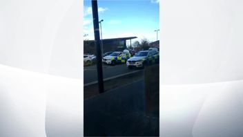 Armed police at the scene of leisure park where gunman is holding hostages.