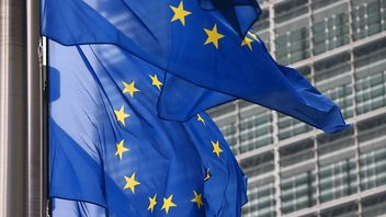 EU flag flies outside the European Commission in Brussels