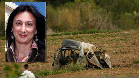 A forensics expert walks in a field after a powerful bomb blew up a car killing investigative journalist Daphne Caruana Galizia in Bidnija, Malta