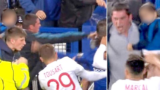 The Everton football thug hits a Lyon player whilst holding a child. Pic: BT Sport