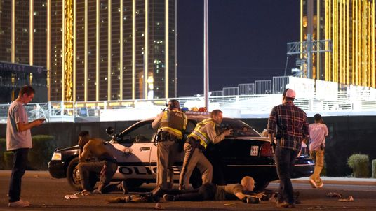 Las Vegas police stand guard along the streets outside the the Route 91 Harvest country music festival