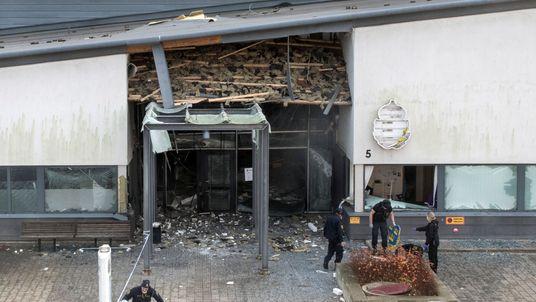 Police investigators examine the scene in Helsingborg, Sweden, after an explosion