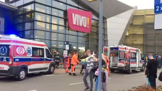A victim is taken away in an ambulance following the stabbing attack in Stalowa Wola