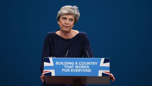 MANCHESTER, ENGLAND - OCTOBER 04: British Prime Minister Theresa May delivers her keynote speech to delegates and party members on the last day of the Conservative Party Conference at Manchester Central on October 4, 2017 in Manchester, England. The prime minister rallied members and called for the party to 'shape up' and 'go forward together'. Theresa May also announced a major programme to build council houses and a cap on energy prices. (Photo by Carl Court/Getty Images)