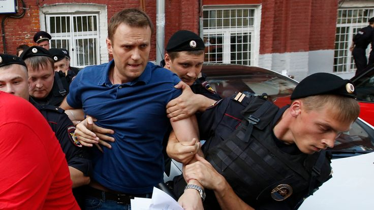 Policemen detain Russian opposition leader and anti-corruption blogger Alexei Navalny