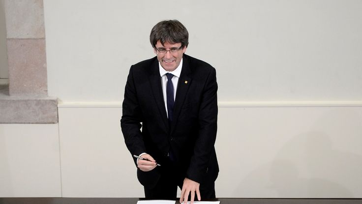 Carles Puigdemont signs Catalonia's independence declaration