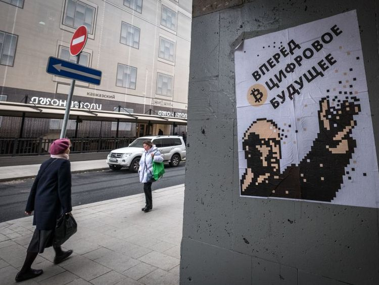 A poster in Moscow depicts communist leader Lenin as a champion of Bitcoin