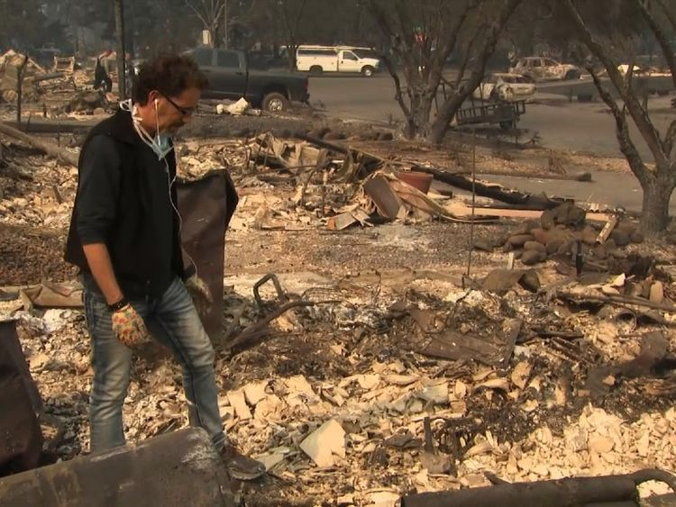 Brad Hoffman looks ate the devastation left by the wildfire