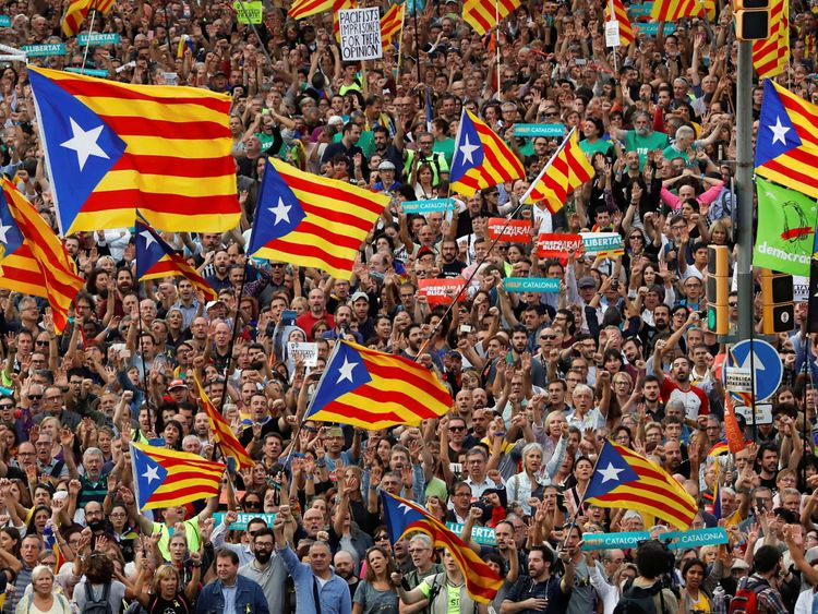 People wave Catalan separatist flags in Barcelona