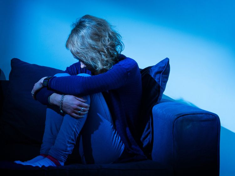 A woman showing signs of depression