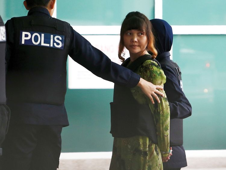 Vietnamese Doan Thi Huong who is on trial for the killing of Kim Jong Nam, the estranged half-brother of North Korea's leader, is escorted as she arrives at the Department of Chemistry in Petaling Jaya, near Kuala Lumpur, Malaysia October 9, 2017