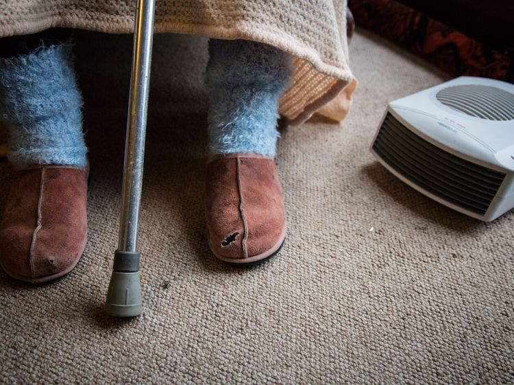 In this photo illustration an elderly person sits in a chair at home on February 16, 2015 near Bristol, England