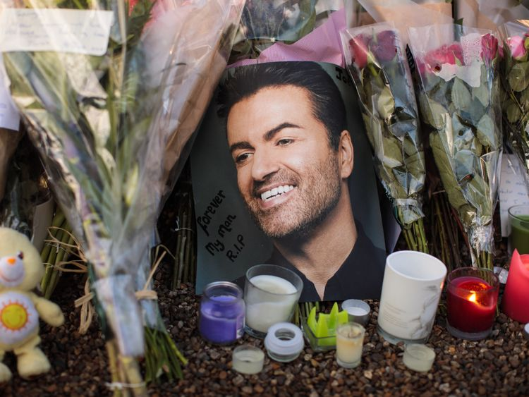 Flowers, photographs and candles outside George Michael's home after the singer died on Christmas day, 2016
