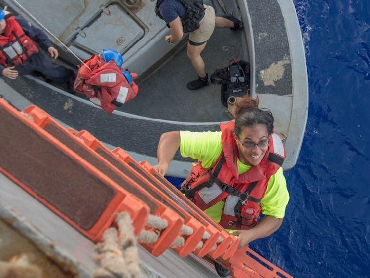 Jennifer Appel climbing aboard the USS Ashland