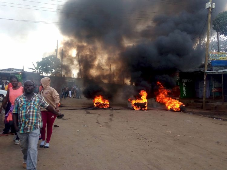 Tyres burn on the streets in Kibera, Nairobi, Kenya October 25, 2017 in this picture obtained from social media. FACEBOOK: STEVE KYENZE via REUTERS THIS IMAGE HAS BEEN SUPPLIED BY A THIRD PARTY. MANDATORY CREDIT. NO RESALES. NO ARCHIVES. MUST ON SCREEN COURTESY FACEBOOK: STEVE KYENZE/NO RESALE