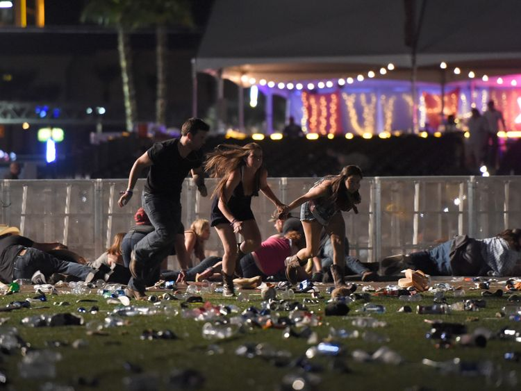 People run from the Route 91 Harvest country music festival after gun fire was heard