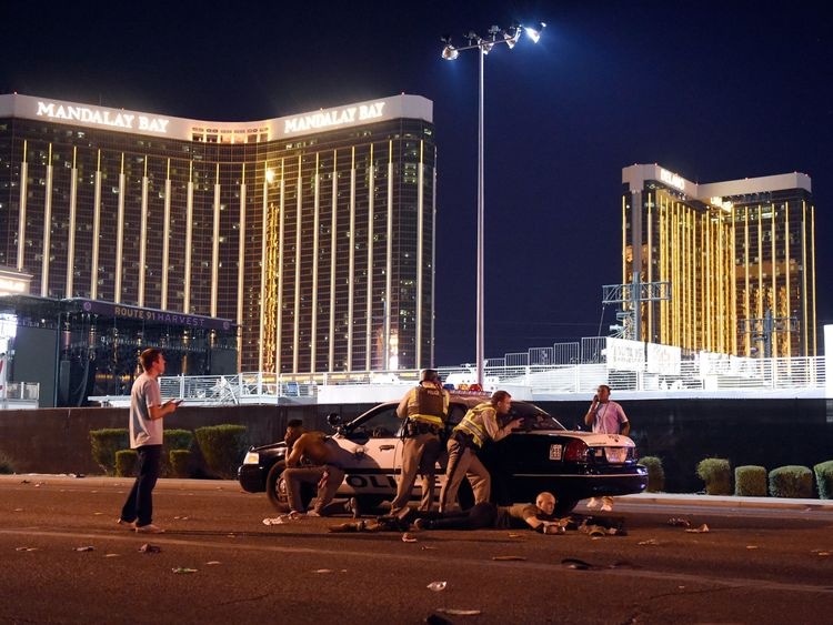 Las Vegas police stand guard along the streets outside the festival grounds of the Route 91 Harvest