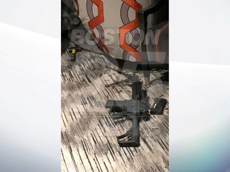 One of the semi-automatic weapons with bullet casings covering the floor. Pic: Fox25Boston