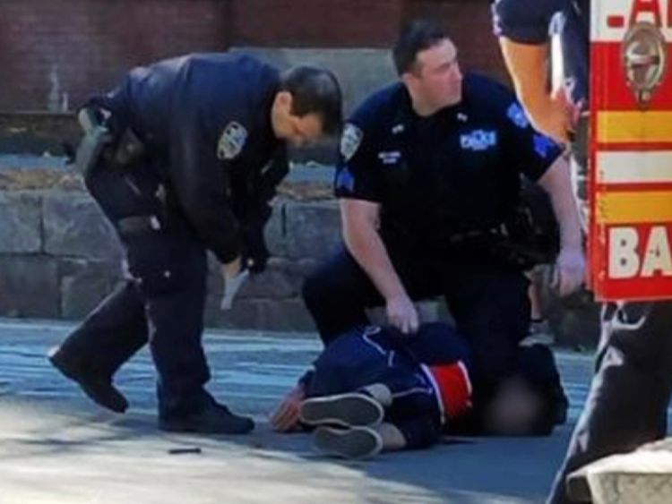 NYPD officers with the suspect moments after he was shot