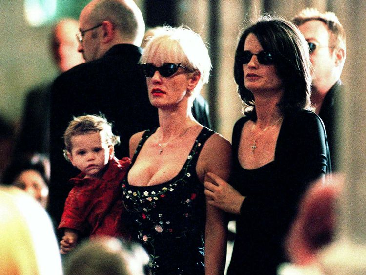Paula Yates holds Tiger Lily at Hutchence's funeral in Sydney