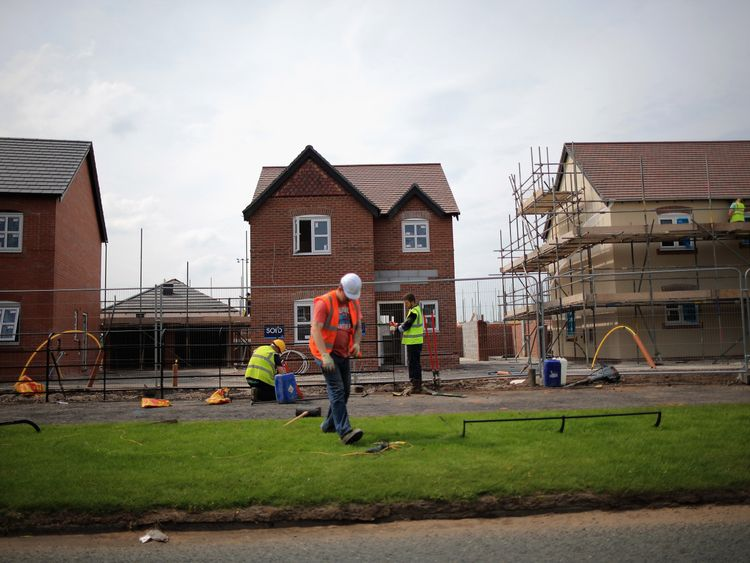 MIDDLEWICH, ENGLAND - MAY 20:  Construction workers build new houses on a housing development on May 20, 2014 in Middlewich, England. Official figures have shown that house prices have risen by 8% in the year ending in March. There have been calls by some experts for the UK Help to Buy scheme to scaled down as it boosts the property market.  (Photo by Christopher Furlong/Getty Images)