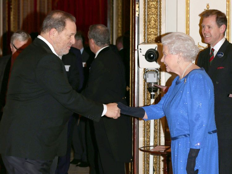 Queen Elizabeth II meets Harvey Weinstein during the Dramatic Arts reception at Buckingham Palace on February 17, 2014