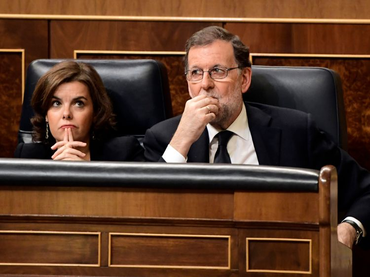 Prime Minister Mariano Rajoy (R) talks with Spanish Vice Prime Minister Soraya Saenz de Santamaria at the Congress of Deputies in Madrid on June 13