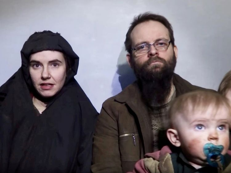 A still image from a video posted by the Taliban on social media on December 19, 2016 shows American Caitlan Coleman speaking next to her Canadian husband Joshua Boyle and their two sons