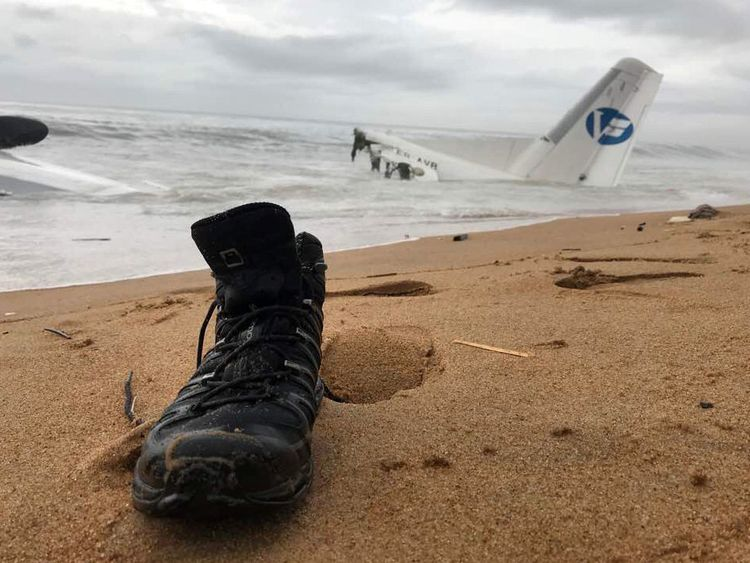 A shoe on the beach after six people were rescued from a down plane in Ivory Coast