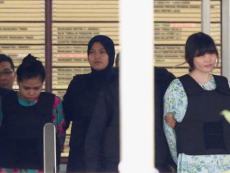 Siti Aisyah (L) and Doan Thi Huong outside court