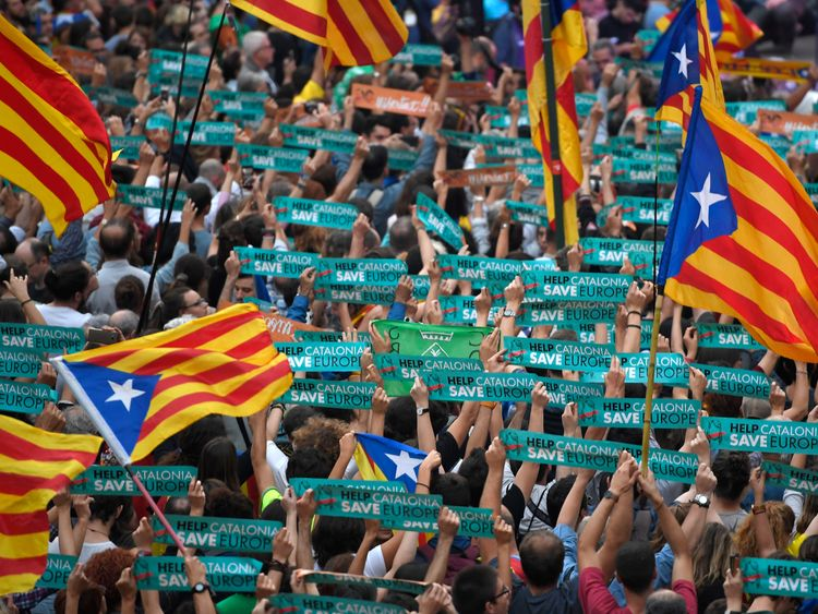 People wave Catalan flags as they celebrate at the Sant Jaume square in Barcelona on October 27, 2017. Catalonia's parliament voted to declare independence from Spain and proclaim a republic, just as Madrid is poised to impose direct rule on the region to stop it in its tracks. A motion declaring independence was approved with 70 votes in favour, 10 against and two abstentions, with Catalan opposition MPs walking out of the 135-seat chamber before the vote in protest at a declaration unlikely to