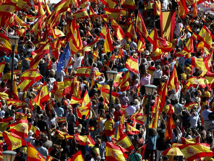 People take part in a pro-union demonstration in Madrid