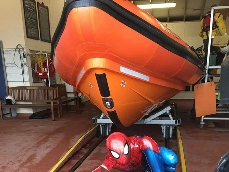The Spider-Man balloon looks relieved to be on dry land again. Pic: RNLI