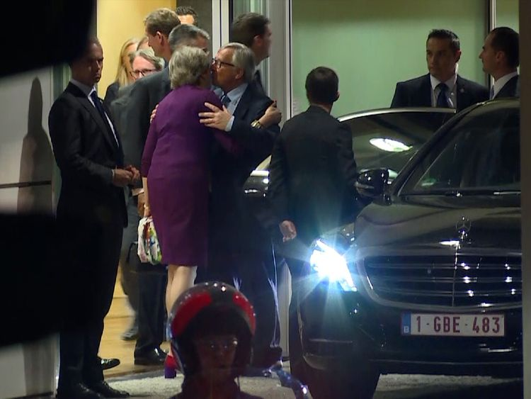 Theresa May and Jean-Claude Juncker embrace following talks in Brussels