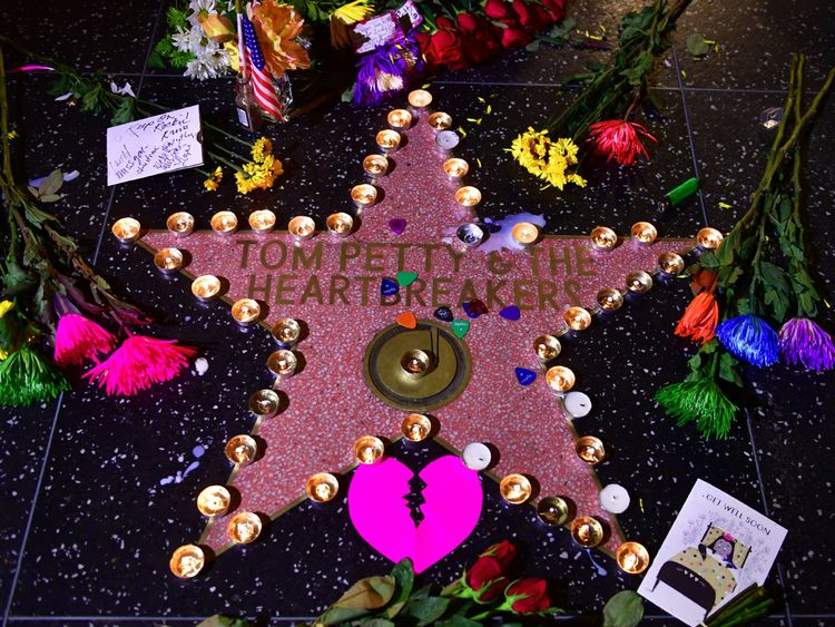 Candles and flowers are placed on the Hollywood Walk of Fame Star of the late Tom Petty in Hollywood, California on October 2, 2017