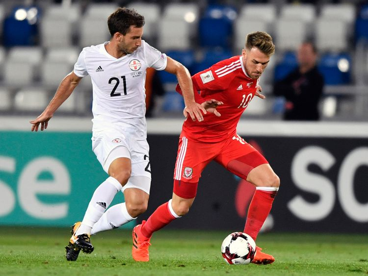 Otar Kakabadze (L) and  Aaron Ramsey vie for the ball during the FIFA World Cup 2018 qualification match between Georgia and Wales