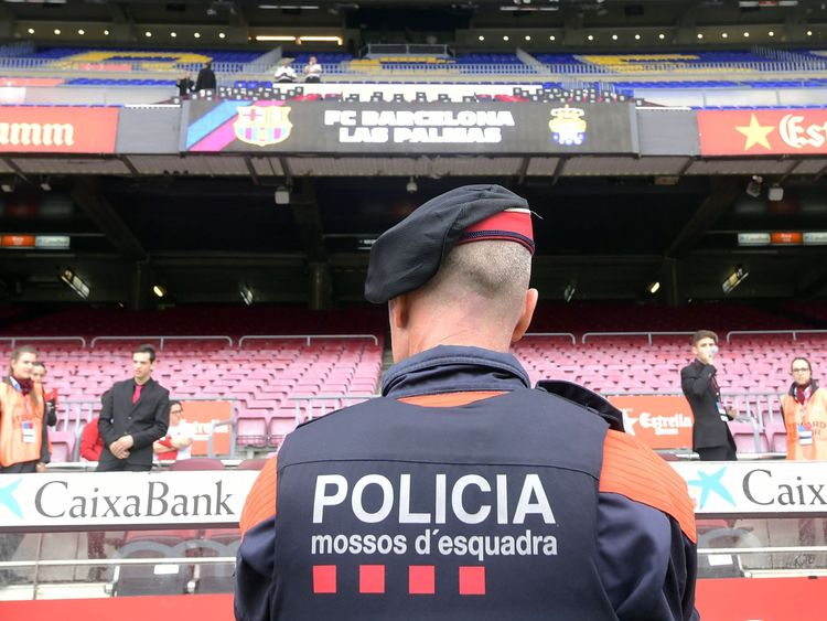 A police officer stands in front of empty stands after the decision to play Barcelona-Las Palmas behind closed doors