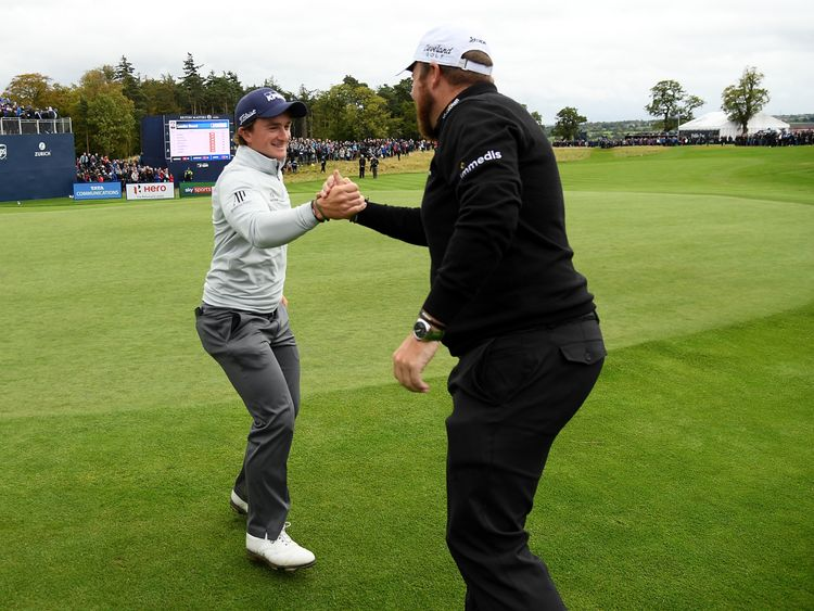 NEWCASTLE UPON TYNE, ENGLAND - OCTOBER 01:  Paul Dunne of Ireland is congratulated by Shane Lowry of Ireland during day four of the British Masters at Clos