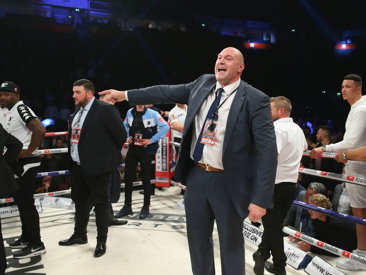 MANCHESTER, ENGLAND - SEPTEMBER 23:  Tyson Fury rants at a member of the British Boxing Board of Control after the WBO World Heavyweight Title fight betwee