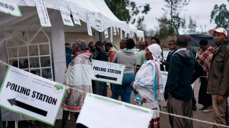 Voters queue to cast their ballots at a primary school in Mathare, Nairobi